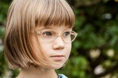 Menina loura pequena com vidros Imagem de Stock Royalty Free