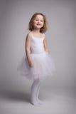 Menina loura pequena em um vestido do bailado fotografia de stock royalty free