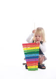 Menina loura pequena que joga o músico Fotos de Stock
