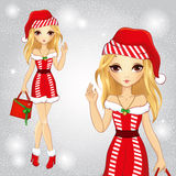 Menina loura vestida como Santa Claus Holding um saco Ilustração Royalty Free