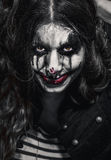 Menina má assustador do palhaço Fotos de Stock Royalty Free