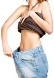 Menina magro em calças de brim grandes do tamanho Imagem de Stock