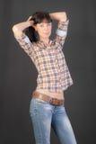 Menina magro na camisa e nas calças de brim Fotos de Stock
