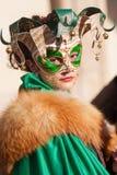 Menina mascarada Fotografia de Stock Royalty Free