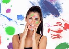 Menina moreno atrativa com sua cara pintada fotografia de stock royalty free