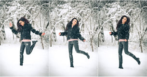 Menina moreno atrativa no preto que levanta o jogo no cenário do inverno Jovem mulher bonita com cabelo longo que aprecia a neve fotografia de stock royalty free