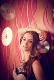 Menina moreno bonita com os CD brilhantes múltiplos Imagem de Stock Royalty Free