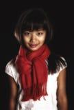 Menina moreno bonita em um lenço vermelho em torno de seu pescoço imagens de stock royalty free