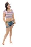 Menina moreno consideravelmente nova com as calças de brim do short no branco Fotos de Stock Royalty Free