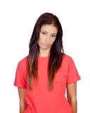 Menina moreno deprimida vestida no vermelho Foto de Stock Royalty Free