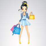 A menina moreno faz a compra Imagem de Stock