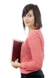 Menina moreno nova com a tabuleta isolada no fundo branco Fotos de Stock Royalty Free