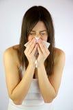 Menina muito doente que sneezing Imagens de Stock Royalty Free