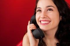 Menina muito feliz no telefone Fotografia de Stock