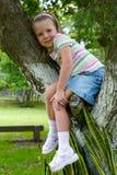 Menina na árvore Fotos de Stock