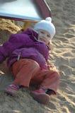 Menina na areia Imagens de Stock