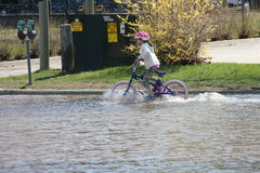 Menina na bicicleta Foto de Stock