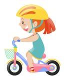 Menina na bicicleta azul da equitação do vestido Imagem de Stock