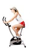 A menina na bicicleta do exercício imagens de stock royalty free