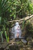 Menina na cachoeira Fotos de Stock
