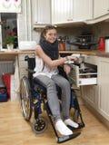 Menina na cadeira de rodas Foto de Stock Royalty Free