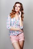 Menina na camisa quadriculado Foto de Stock Royalty Free