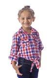 Menina na camisa quadriculado e nas calças de brim Foto de Stock Royalty Free
