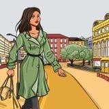 Menina na capa de chuva verde após a compra ilustração stock