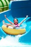 Menina na corrediça de água Imagem de Stock Royalty Free