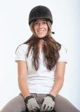 Menina na engrenagem da equitação Foto de Stock Royalty Free