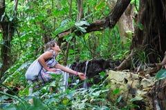 A menina na floresta húmida Foto de Stock Royalty Free