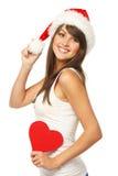 Menina na forma do coração da terra arrendada do chapéu de Santa Imagens de Stock Royalty Free