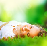 Menina na grama verde Foto de Stock Royalty Free