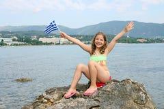 Menina na ilha Grécia de Corfu das férias de verão imagens de stock