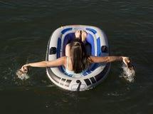 Menina na jangada do rio Imagem de Stock