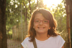Menina na luz solar Foto de Stock Royalty Free