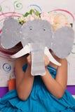 Menina na máscara do papel do elefante Imagens de Stock
