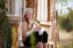 Menina na moda fora da casa Foto de Stock Royalty Free