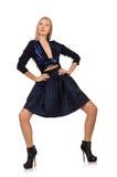 Menina na obscuridade - saia azul do cabelo louro isolada sobre Imagem de Stock