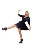 Menina na obscuridade - saia azul do cabelo louro isolada sobre Imagens de Stock Royalty Free