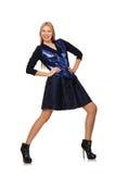 Menina na obscuridade - saia azul do cabelo louro isolada sobre Fotos de Stock