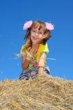 A menina na palha fotos de stock royalty free