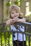 Menina na ponte Imagens de Stock