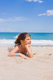 A menina na praia Imagem de Stock