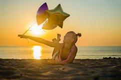 A menina na praia Fotografia de Stock