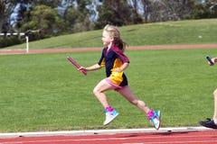 Menina na raça dos esportes Fotografia de Stock Royalty Free