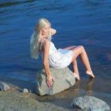 Menina na rocha Imagem de Stock