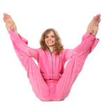 A menina na roupa cor-de-rosa faz o exercício ginástico imagem de stock royalty free