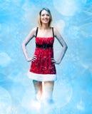 Menina na roupa de Papai Noel no teste padrão da neve Imagens de Stock Royalty Free