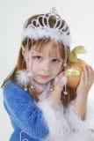 Menina na roupa do Natal com brinquedo Fotos de Stock